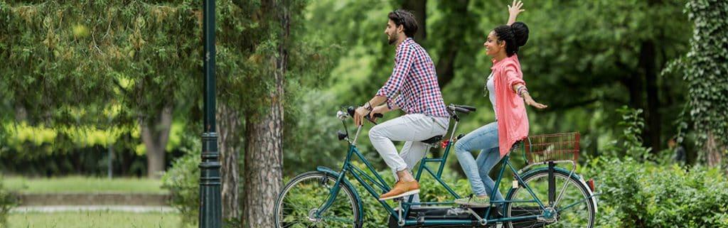 couple riding a tandem bike