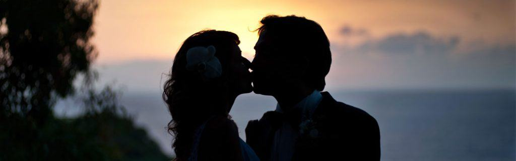 silhouette of a husband and wife kissing
